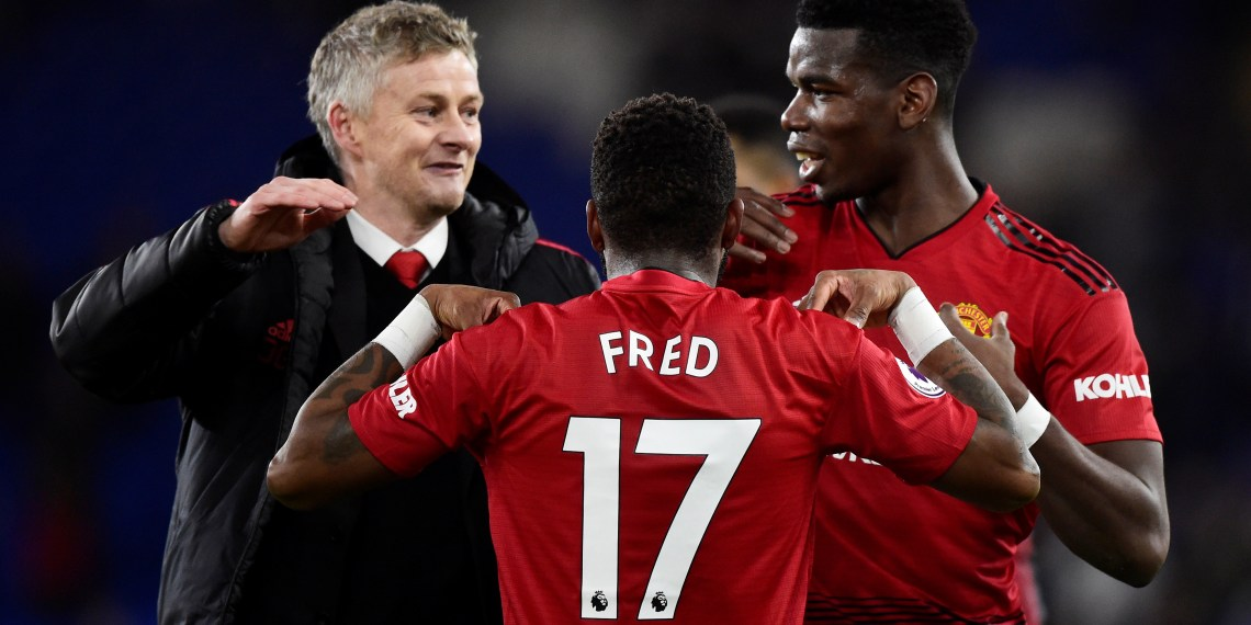 Soccer Football - Premier League - Cardiff City v Manchester United - Cardiff City Stadium, Cardiff, Britain - December 22, 2018  Manchester United's Paul Pogba and Fred celebrate after the match with interim manager Ole Gunnar Solskjaer  REUTERS/Rebecca Naden