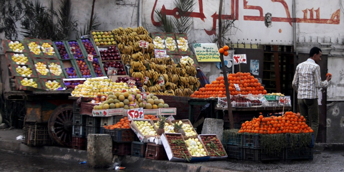 A vendor stands next to his fruit stall as he waits for customers near a mosque in Cairo March 11, 2013. REUTERS/Amr Abdallah Dalsh