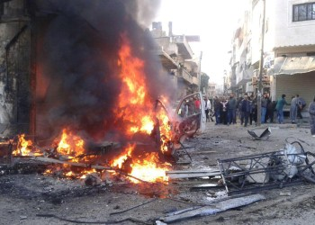 People gather at a site of a car bomb blast at the Syrian city of Latakia, Syria in this handout released by SANA on January 22, 2019. SANA/Handout via REUTERS