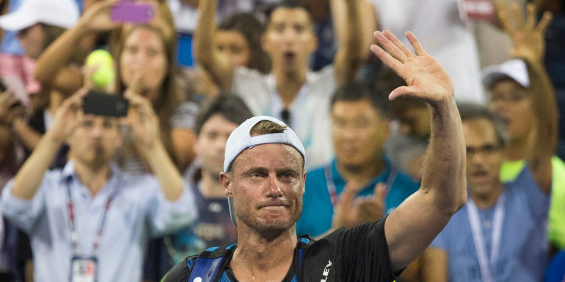 Lleyton Hewitt of Australia waves to fans as he walks off the court following his loss to compatriot Bernard Tomic in their second round match at the U.S. Open Championships tennis tournament in New York, September 3, 2015. REUTERS/Adrees Latif