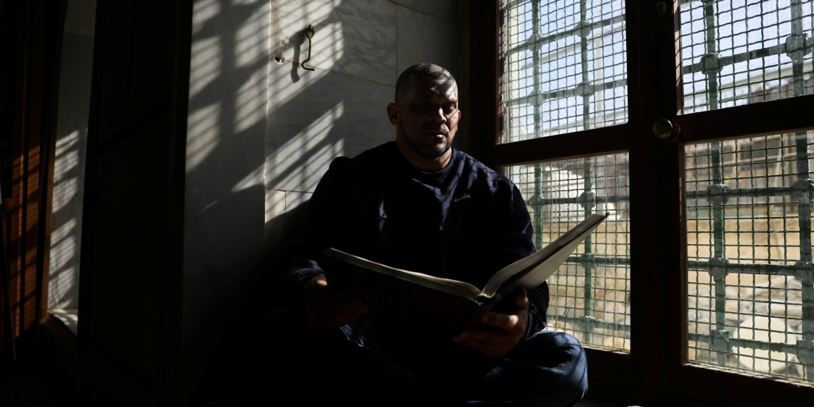 Ibrahim al-Masri, reads from a Koran on his last day as the chief muezzin of the Al-Jazzar Mosque, in Acre, northern Israel January 31, 2019. Picture taken January 31, 2019. REUTERS/Ammar Awad