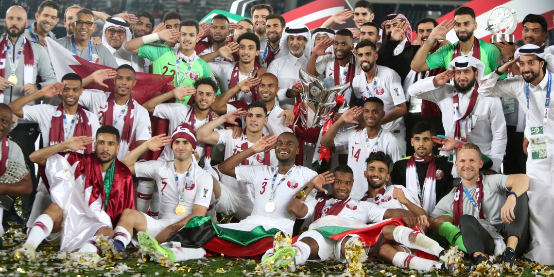 FILE PHOTO: Soccer Football - AFC Asian Cup - Final - Japan v Qatar - Zayed Sports City Stadium, Abu Dhabi, United Arab Emirates - February 1, 2019 Qatar players and coaching staff pose wit the trophy after winning the Asian Cup. REUTERS/Suhaib Salem