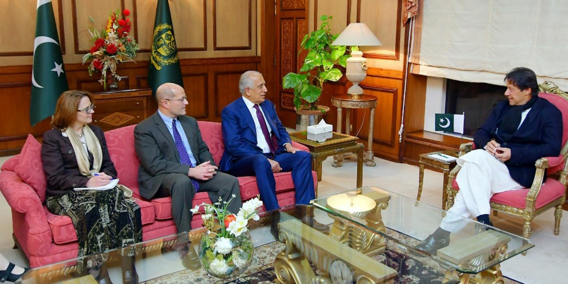 FILE PHOTO: Pakistani Prime Minister Imran Khan (R) speaks with U.S. special envoy Zalmay Khalilzad (3rd L) during a meeting at the Prime Minister's office in Islamabad, Pakistan, in this handout photo released January 18, 2018. Press Information Department (PID)/Handout via REUTERS