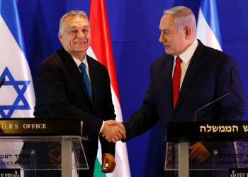 Hungarian Prime Minister Viktor Orban and Israeli Prime Minister Benjamin Netanyahu shake hands after their meeting in Jerusalem February 19, 2019. Ariel Schalit /Pool via REUTERS