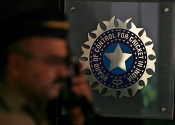 FILE PHOTO: A policeman walks past a logo of the Board of Control for Cricket in India (BCCI) during a governing council meeting of the Indian Premier League (IPL) at BCCI headquarters in Mumbai April 26, 2010. REUTERS/Arko Datta