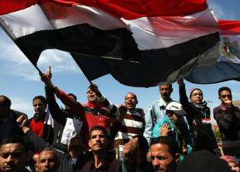 Protesters wave Egyptian flags at Cairo's Tahrir Square as hundreds demonstrate against sectarianism on March 11, 2011. (AFP)