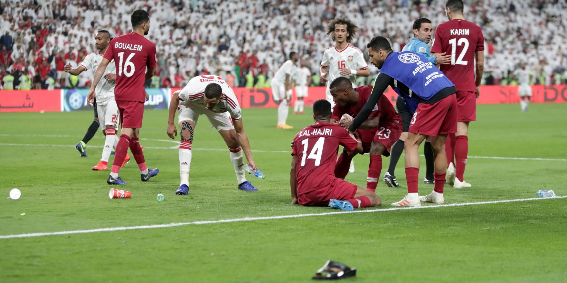 FILE PHOTO: Soccer Football - AFC Asian Cup - Semi-Final - Qatar v United Arab Emirates - Mohammed bin Zayed Stadium, Abu Dhabi, United Arab Emirates - January 29, 2019   Qatar players celebrate after Hasan Al Haydos scored their third goal as objects are thrown onto the pitch  REUTERS/Suhaib Salem