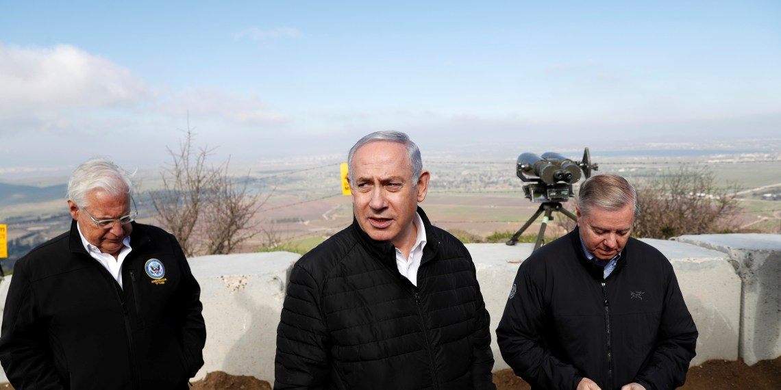 Israeli Prime Minister Benjamin Netanyahu, U.S. Republican Senator Lindsey Graham and U.S. Ambassador to Israel David Friedman visit the border line between Israel and Syria at the Israeli-occupied Golan Heights March 11, 2019 REUTERS/Ronen Zvulun