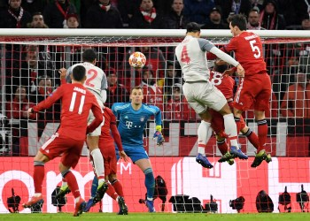 FILE PHOTO - Soccer Football - Champions League - Round of 16 Second Leg - Bayern Munich v Liverpool - Allianz Arena, Munich, Germany - March 13, 2019  Liverpool's Virgil van Dijk scores their second goal   REUTERS/Andreas Gebert