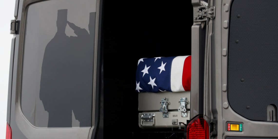 FILE PHOTO: The casket carrying the remains of Scott Wirtz, a civilian employee of the U.S. Defense Intelligence Agency killed along with three members of the U.S. military during a recent attack in Syria, sits in a military vehicle during a dignified transfer ceremony as they are returned to the United States at Dover Air Force Base, in Dover, Delaware, U.S., January 19, 2019. REUTERS/Kevin Lamarque/File Photo