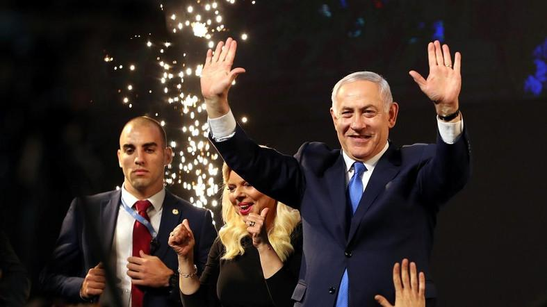 Benjamin Netanyahu and his wife Sara react following the announcement of exit polls in Tel Aviv on April 10, 2019. (Reuters)