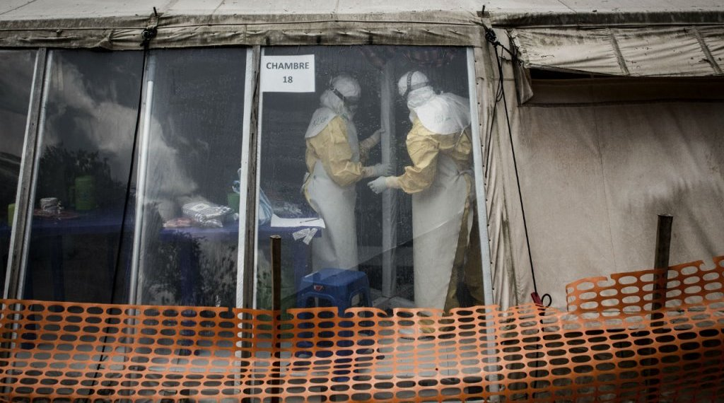 John Wessels, AFP | In this file photo taken on March 9, 2019, health workers are seen inside the 'red zone' of an Ebola treatment centre, which was attacked in the early hours of the morning in Butembo.