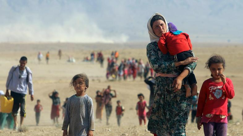 A file photo of a Yazidi woman with children suffering from the atrocities of ISIS. (Reuters)