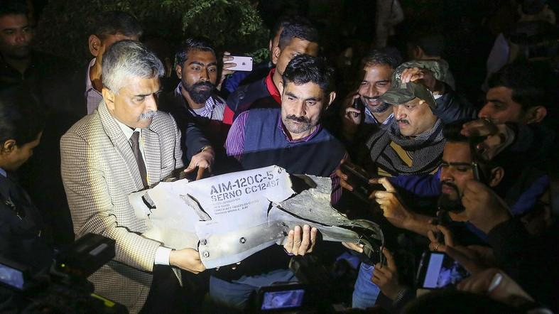 Indian Air Force officials show a section of an exploded AMRAAM missile, said to be fired by Pakistan Air Force (PAF) F-16. (AFP)
