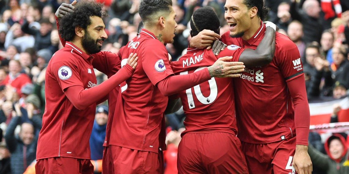 LIVERPOOL, ENGLAND - APRIL 14: Sadio Mane of Liverpool (10) celebrates after scoring his team's first goal with Virgil van Dijk, Roberto Firmino and Mohamed Salah during the Premier League match between Liverpool FC and Chelsea FC at Anfield on April 14, 2019 in Liverpool, United Kingdom. (Photo by Michael Regan/Getty Images)