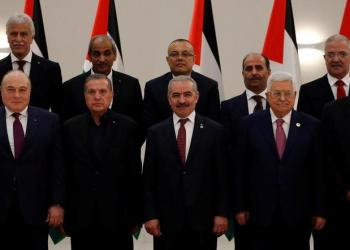 Palestinian President Mahmoud Abbas stands next to new Prime Minister Mohammad Shtayyeh and other members of the new government during a swearing-in ceremony. (Reuters)