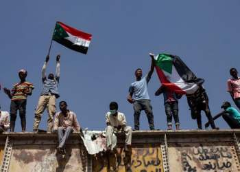 Sudanese protesters wave national flags at the sit-in outside the military headquarters, in Khartoum on May 2, 2019. (AP)