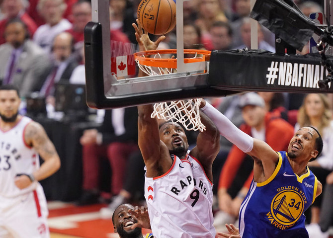 Toronto Raptors center Serge Ibaka (9) shoots while defended by Golden State Warriors guard Shaun Livingston (34) during the first quarter in game two of the 2019 NBA Finals at Scotiabank Arena. (USA TODAY Sports/Kyle Terada)