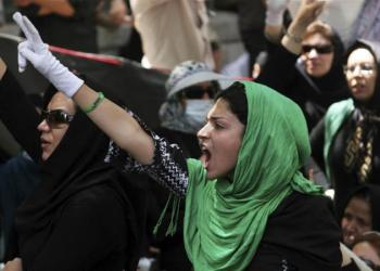 Iranian protesters flash victory signs during a protest after Friday prayers at a university in Tehran on July 17, 2009 [File: Reuters]