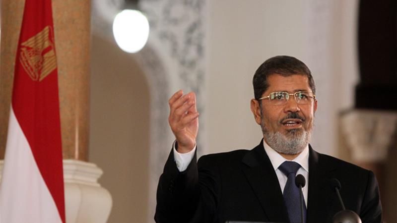 State TV said former Egyptian President Mohamed Morsi collapsed during his court session and died [File: Khaled Elfiqi/EPA]