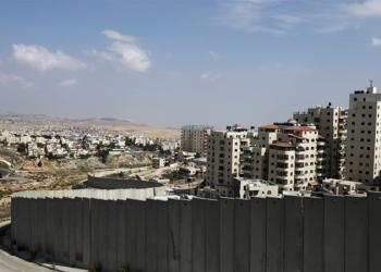 Shuafat refugee camp (right) in occupied East Jerusalem may be excised out of the Jerusalem municipality's jurisdiction [Ammar Awad/Reuters]