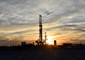 FILE PHOTO: Drilling rigs operate at sunset in Midland, Texas, U.S., February 13, 2019. REUTERS/Nick Oxford/File Photo