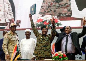 The agreement was signed by the deputy head of Sudan's Transitional Military Council, Gen. Mohamed Hamdan Dagalo, and Ahmed Rabie. (AFP)
