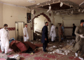 Members of a bomb disposal unit survey the site after a blast at a mosque in Kuchlak, in the outskirts of Quetta, Pakistan August 16, 2019. REUTERS/Stringer