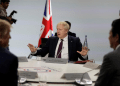Britain's Prime Minister Boris Johnson gestures ahead of a working session on World Economy and Trade on the second day of the G-7 summit in Biarritz, France August 25, 2019.Markus Schreiber/Pool via REUTERS