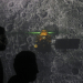 Student walk past a screen during a live streaming of Chandrayaan-2 landing at an educational institute in Mumbai, India, September 7, 2019. REUTERS/Francis Mascarenhas