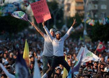 FILE PHOTO: Supporters of the pro-Kurdish Peoples' Democratic Party (HDP) wave party flags during a peace day rally in Diyarbakir, Turkey, September 1, 2019. REUTERS/Sertac Kayar/File Photo