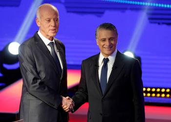 FILE PHOTO: Tunisian presidential candidates Nabil Karoui and Kais Saied shake hands before a televised debate ahead of Sunday's second-round runoff election in Tunis, Tunisia October 11, 2019. REUTERS/Zoubeir Souissi