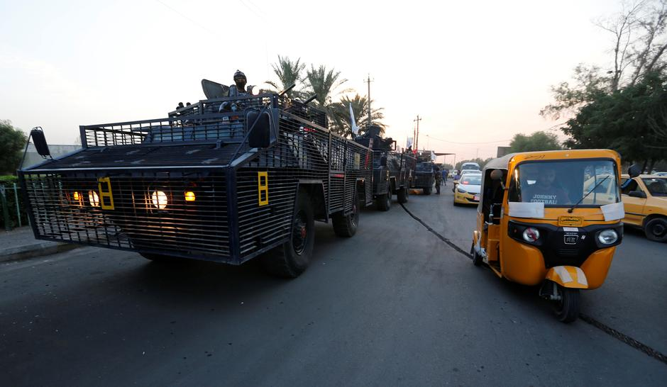 Military vehicles of Iraqi federal police are seen in a street in Baghdad, Iraq October 7, 2019. REUTERS/Wissm al-Okili