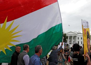 Members of the American Rojava Center for Democracy, an organization that advocates for freedom, democracy, and peace in Syria, take part with other activists in a rally to protest Turkey's incursion into Kurdish-controlled northeast Syria and urge U.S. action against Turkey, outside the White House in Washington, U.S, October 12, 2019. REUTERS/Carlos Jasso