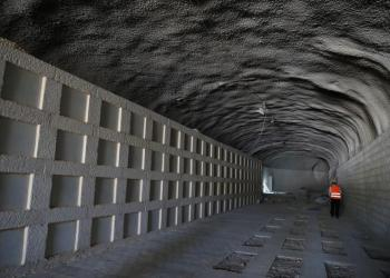 A labourer stands inside a section of a new underground cemetery, still under construction, located at Givat Shaul Cemetery in Jerusalem October 6, 2019. REUTERS/Ammar Awad