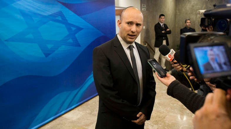 Naftali Bennett speaks with the media ahead of a weekly cabinet meeting in Jerusalem in 2015. (File photo: AP)