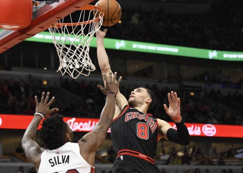 Nov 22, 2019; Chicago, IL, USA; Chicago Bulls guard Zach LaVine (8) shoots over Miami Heat forward Chris Silva (30) during the first half at United Center. Mandatory Credit: David Banks-USA TODAY Sports