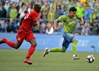 November 10, 2019; Seattle, WA, USA; Seattle Sounders forward Raul Ruidiaz (9) scores a goal against Toronto FC defender Chris Mavinga (23) in the second half during the MLS Cup at CenturyLink Field. Mandatory Credit: Troy Wayrynen-USA TODAY Sports