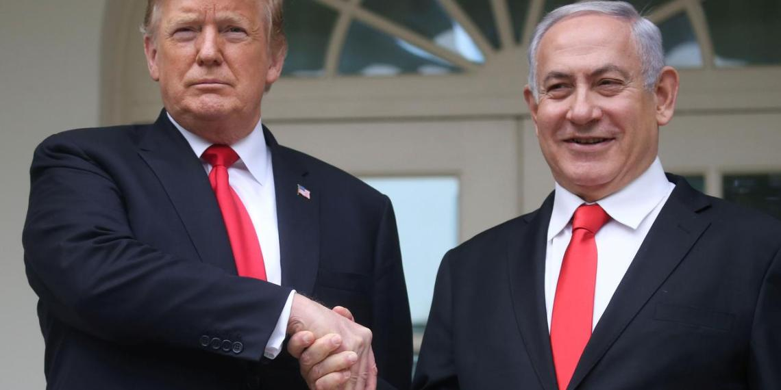 FILE PHOTO: U.S. President Donald Trump shakes hands with Israel's Prime Minister Benjamin Netanyahu as they pose on the West Wing colonnade in the Rose Garden at the White House in Washington, U.S., March 25, 2019. REUTERS/Leah Millis
