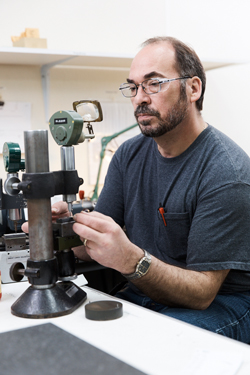 One of GLE's gage makers checks a product on a Mikrokator -- a highly accurate inspection device that measures down to .000002-inch increments.
