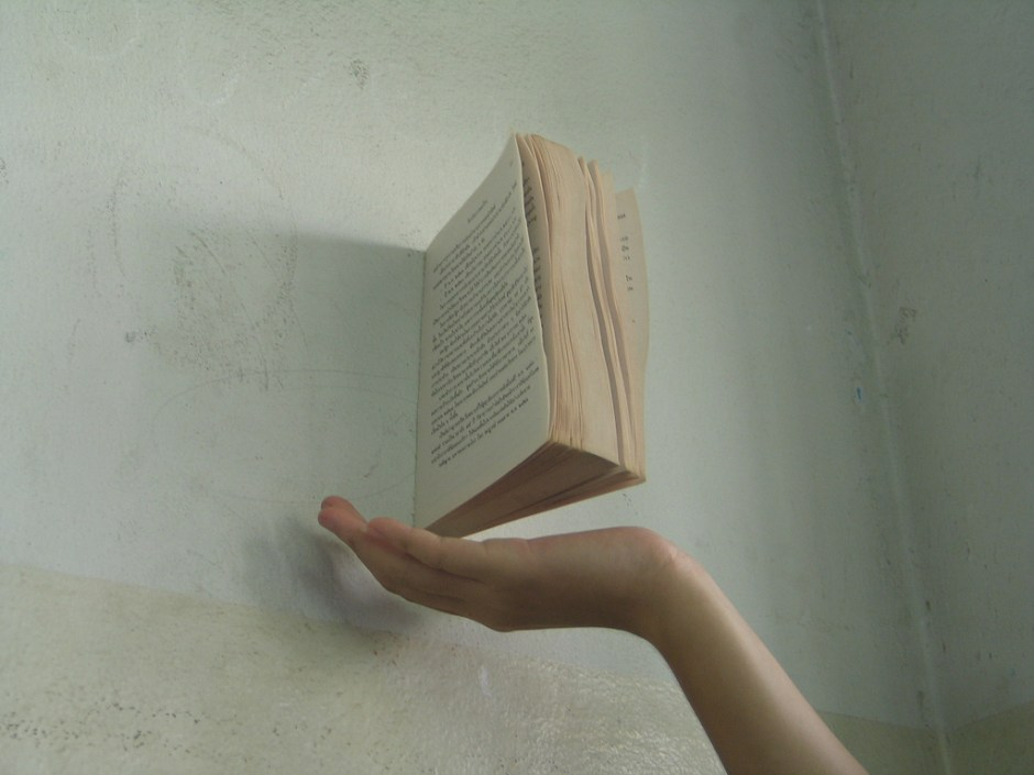 Book floating against a wall