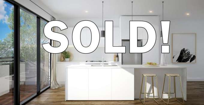 SOLD! over a kitchen picture
