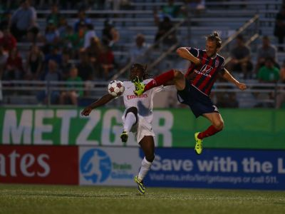 Cory Miller Challenges Lucky Mkosana For A Ball (Photo Credit: NY Cosmos)