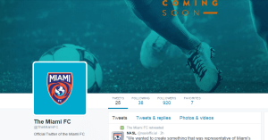The 'Coming Soon' header image used by Miami FC on Twitter which displays orange text on a teal tinted background.