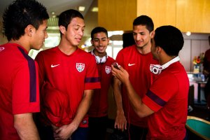 Pineda and Cuevas with teammates at their hotel prior to the 2013 Toulon Tournament. (Photo: Julien Goldstein for the International Herald Tribune)