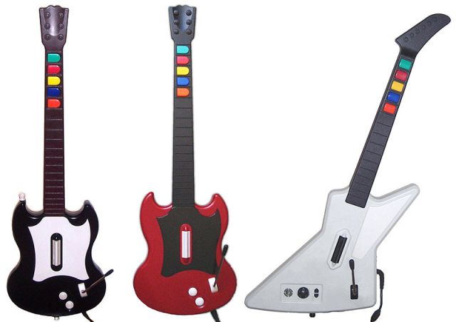 800px-Guitar_Hero_series_controllers Guitar Hero | Relembre o grande sucesso do Rock nos games!