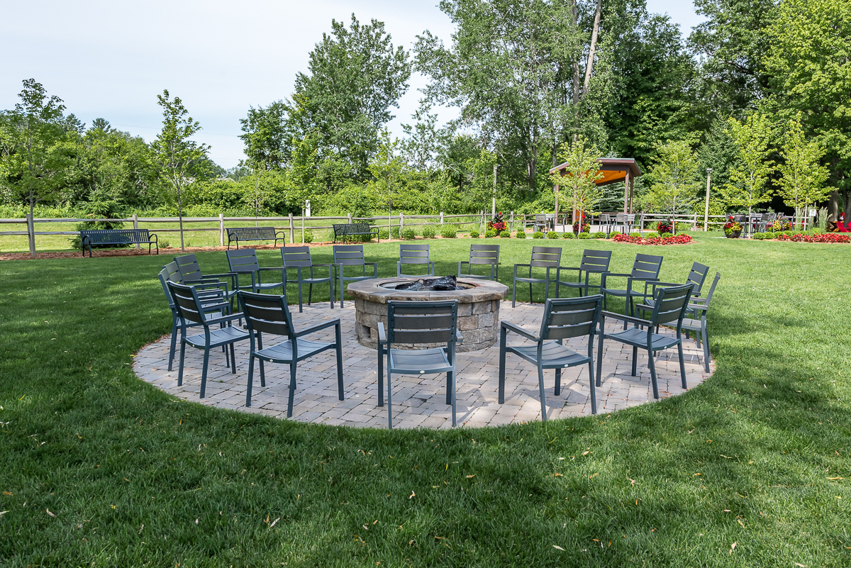 Photo of Midland Brewing Company's firepit and chairs that encircle it so sharing great beer and great stories is easy to do with friends and family.