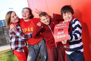 DC 25/11/2016 - REPRO FREE FREE PIC Pupils from Midleton Educate Together School in Cork, Charlie Riff, 12, Elena Byrne, 12, Szymon Nosek,10, and Kyle Campbell, 11, pictured taking part in the  inaugural Wear Red Day against racism organised by Show Racism the Red Card.  Minister of State for Justice with special responsibility for Equality, Immigration and Integration, David Stanton TD, attended a special event at the school, one of many events that took place across the country.  Thousands of people wore red to support Show Racism the Red Card on Friday 25th November across 35 schools and dozens of clubs, colleges and workplaces across Ireland. For further information on the initiative, visit http://www.theredcard.ie/. Pic: Diane Cusack