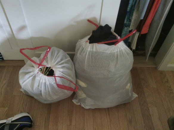 Clothes that no longer fit. To be donated ...
