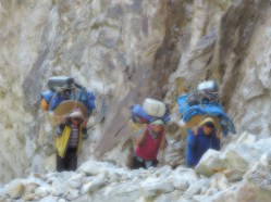 Porters carrying supplies on the trail